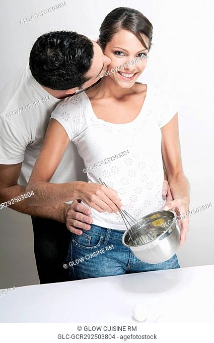Couple romancing in a kitchen