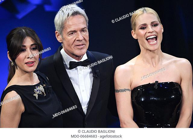 Television host Virginia Raffaele, Claudio Baglioni and Michelle Hunziker during the second evening of the 69th Sanremo Music Festival