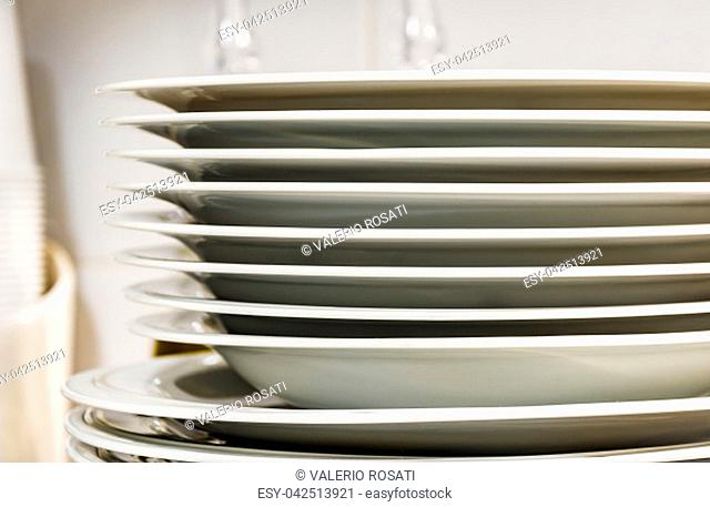 view of a group of stacked dishes in a modern kitchen