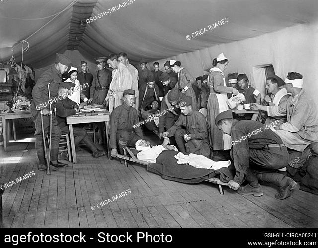 Wounded American Soldiers being received from Ambulances, Evacuation Tent, American Military Hospital No. 5, Auteuil, France, Lewis Wickes Hine