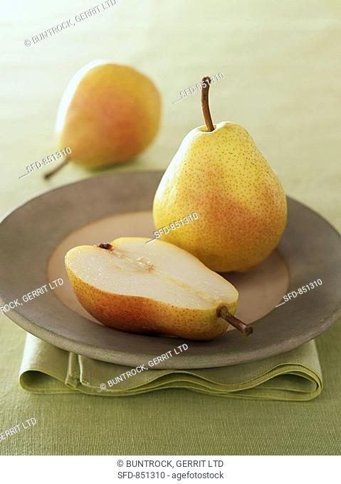 Two whole and one half Williams pear