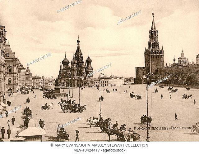View of St Basil's Cathedral (centre) and the Spasskaya Tower (right) in Red Square, the Kremlin complex, Moscow, Russia