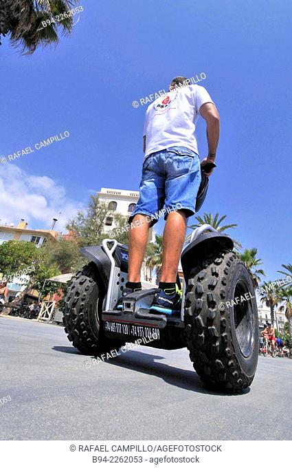 Boy on Segway Two-wheeled electric vehicle, invented by Dean Kamen and introduced the year 2001. Barcelona. Catalonia. Spain