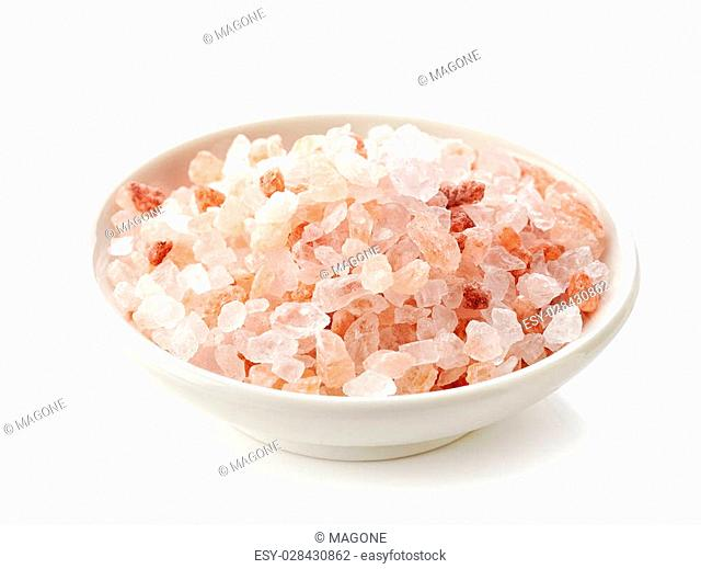 bowl of pink himalayan salt isolated on white background