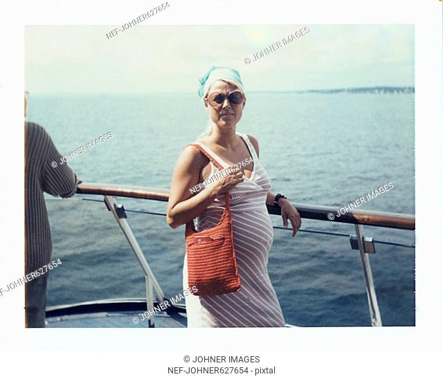 A woman wearing sunglasses on a boat