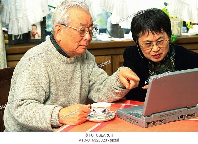 Senior adult man and woman using a laptop computer, High Angle View