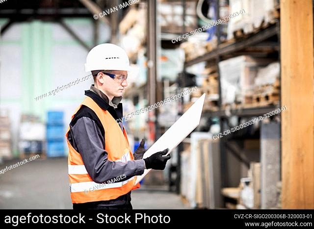 technician male working in a store watching to product