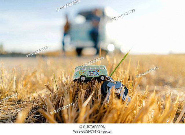 Camper van key on stubble field in rural landscape