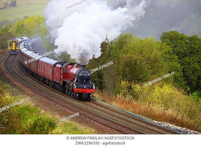 Steam locomotive LMS Jubilee Class 45699 Galatea near Low Baron Wood Farm, Armathwaite ,Eden Valley, Cumbria, England, UK