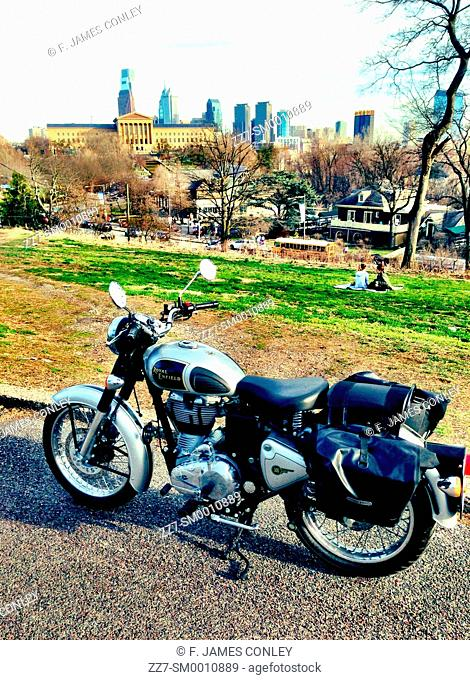 A motorcycle with the Philadelphia skyline in the background
