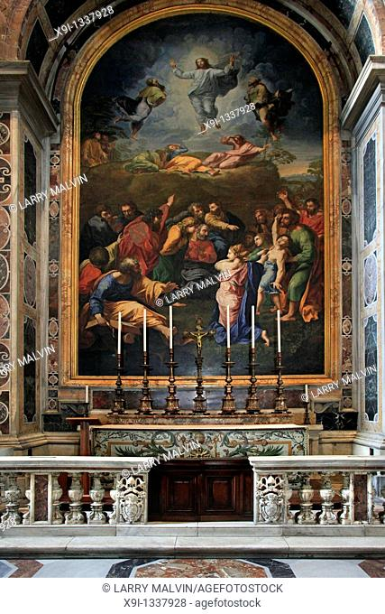 Fresco on the wall with candles on table inside St  Peter's Basilica in the Vatican, Rome, Italy