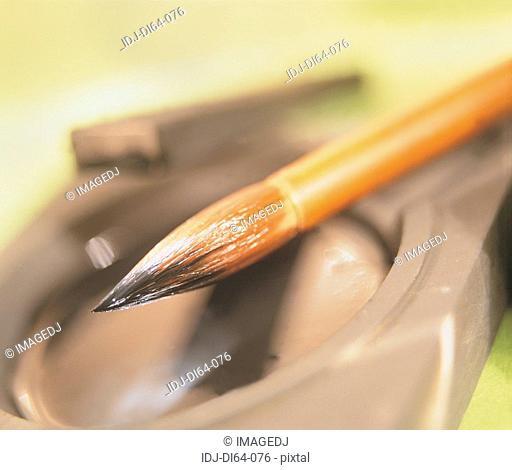 Close-up of a brush and a inkstone