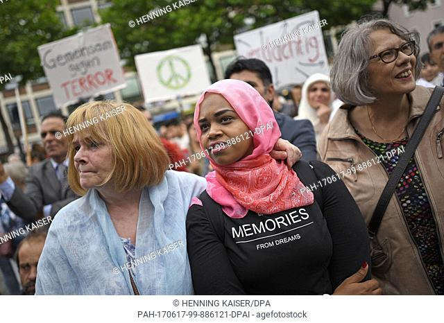 Participants listen to a speech during a peace march by Muslims against Islamist terrorism in Cologne, Germany, 17 June 2017
