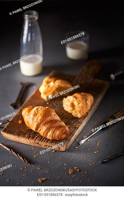 Breakfast at the workshop. Croissant with milk