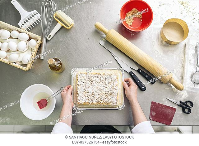 Female pastry chef decorating dessert in the kitchen. Cooking Concept