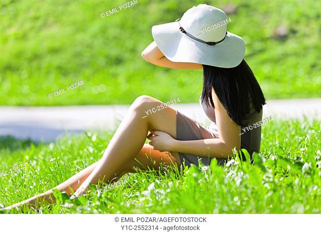 Teen girl on sunny greenfield