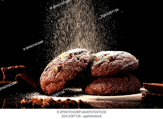 Chocolate chip cookies against a black background
