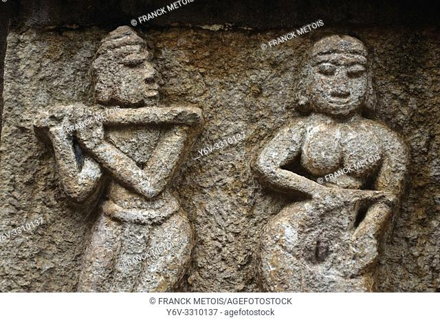 Sculpture representing a couple ( hindu temple at Bhoramdeo, Chhattisgarh, india). The man is playing flute like the hindu god Krishna