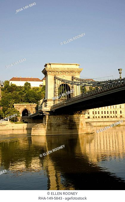 An early morning sail under the Chain Bridge on the Danube River, Budapest, Hungary, Europe