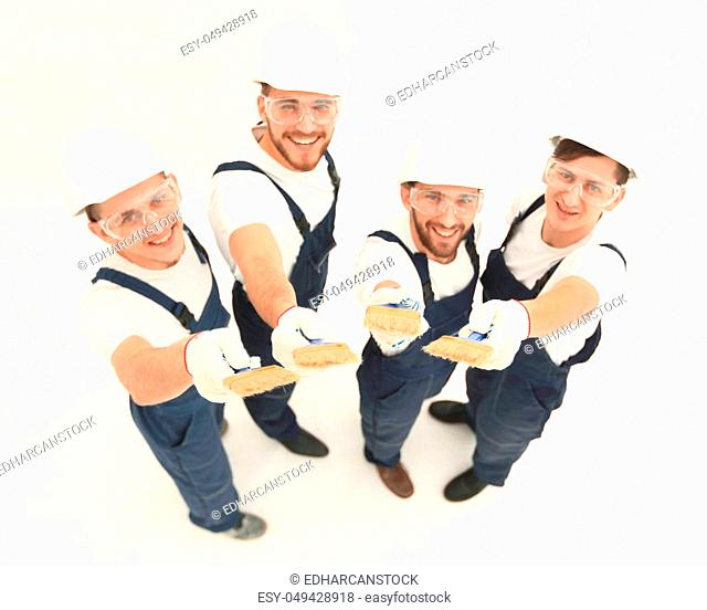 team of construction workers looking at the camera. isolated on white. photo with copy space