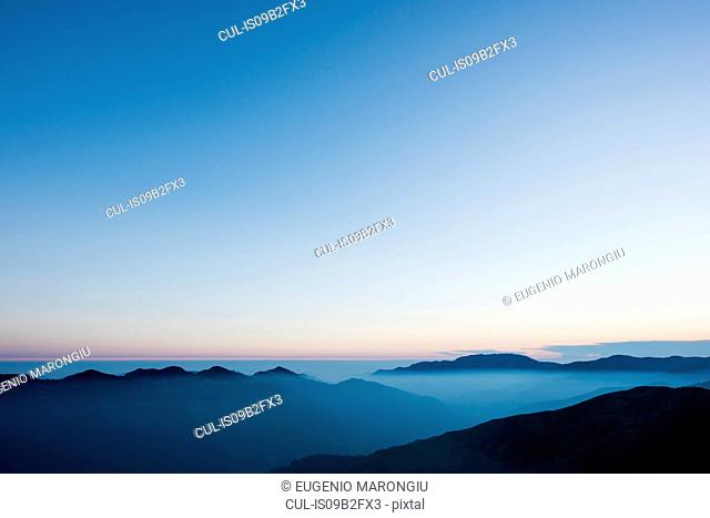 Scenic view of misty mountains, Passo Maniva, Italy