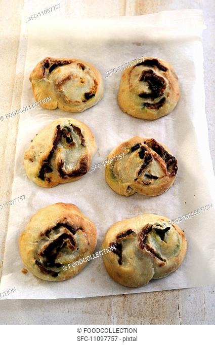 Min pastries filled with salami and courgette