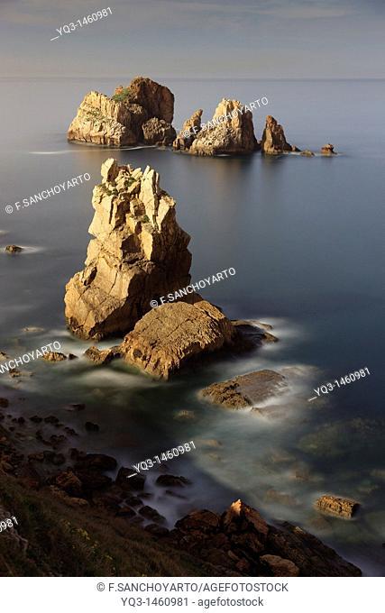 Nigth view of Urros de Liencres rocky isles, Costa Quebrada, Piélagos, Cantabria, Spain
