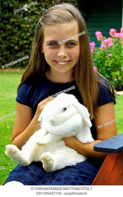 a girl with a bunny