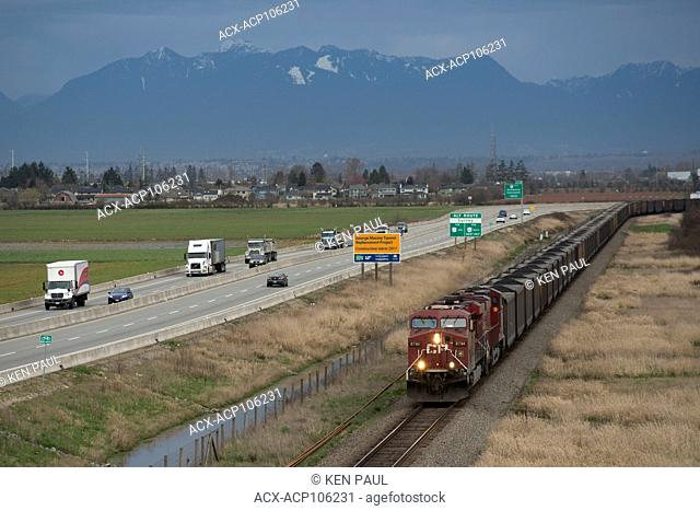 A CP (Canadian Pacific) coal train in Delta, British Columbia Canada nears its terminus of Roberts Bank Superport