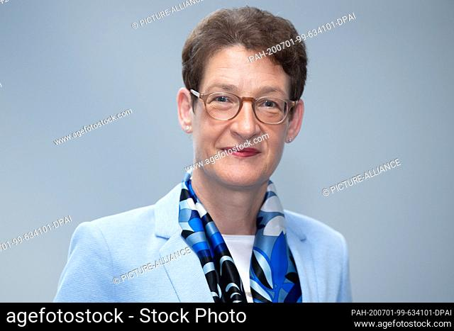 01 July 2020, Saxony, Dresden: Katrin Leonhardt, CEO of the Sächsische Aufbaubank (SAB), is standing on the sidelines of a press conference in the foyer