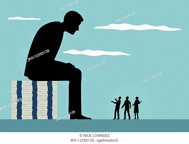 Large businessman sitting on top of piles of money looking down on small people complaining