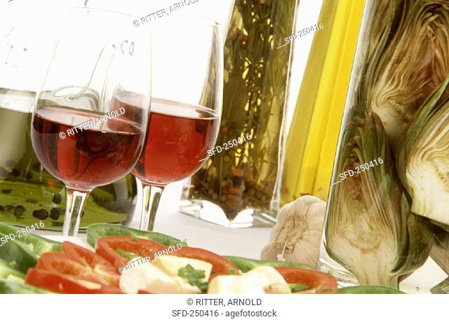 Two glasses of red wine and Italian antipasti