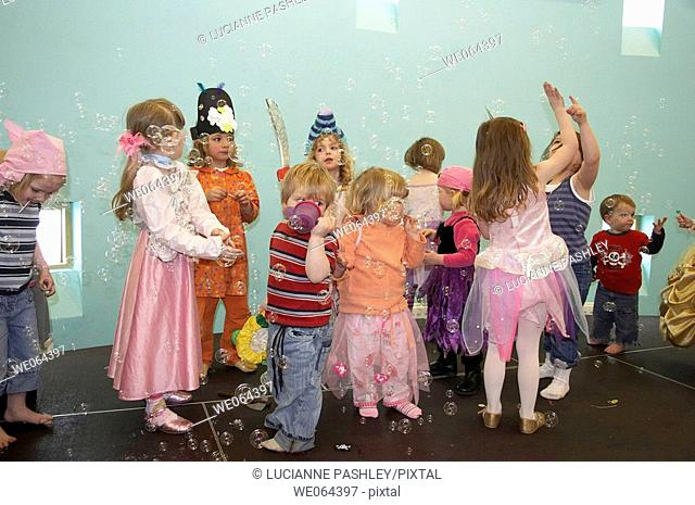 Group of chidren playing with bubbles at a children's pirate party