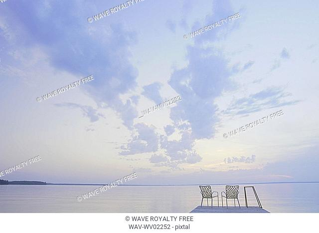 Two folding lawn chairs on dock at Clear Lake, Canada, Manitoba, Riding Mountain National Park