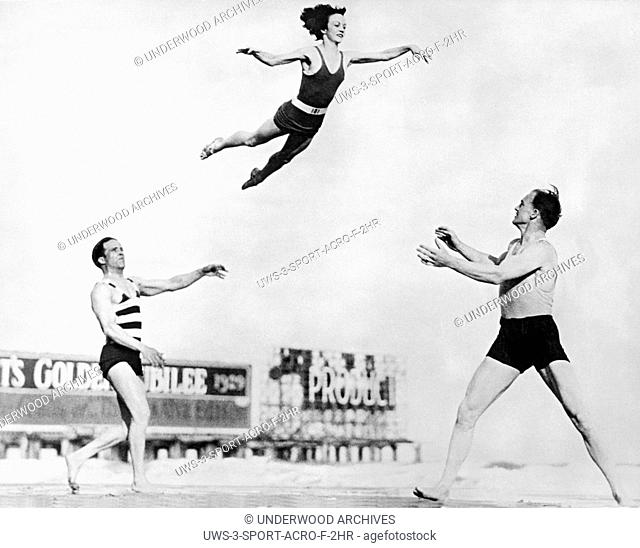 New York, New York: 1929.Three performers from the stage production, Broadway Nights practice their moves on the beach. Eddy and Douglas toss Dolores 16 feet at...