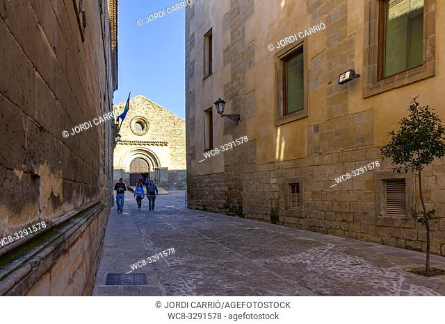 Baeza, Andalusia, Spain: View of one of the streets of the medieval center of Baeza with the Church of the Holy Cross in the background