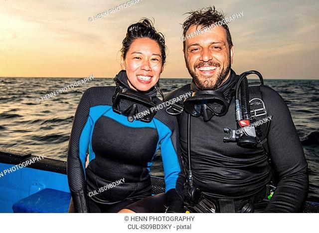 Couple on dive boat, Tubbataha Reefs Natural Park, Sulu Sea, Philippines