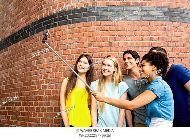Students all taking selfie together