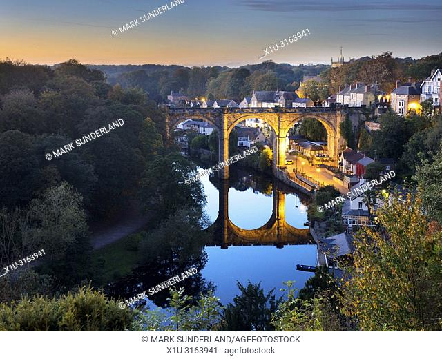 Railay Viaduct over the River Nidd at dusk in early autumn from the Castle Grounds at Knaresborough North Yorkshire England