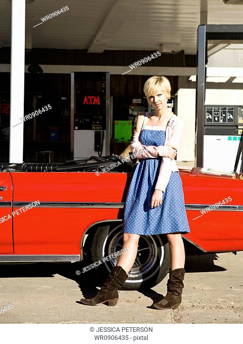 woman with cowboy boots at a gas station