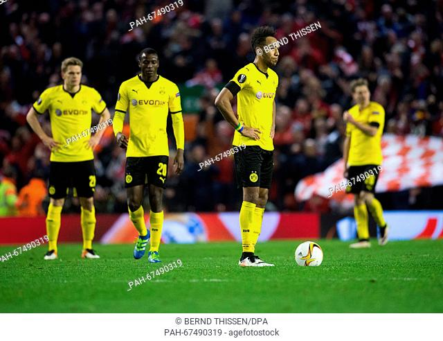 Dortmund's players (L-R) Marcel Schmelzer, Adrian Ramos and Pierre-Emerick Aubameyang react after losing during the UEFA Europa League quarter finals soccer...