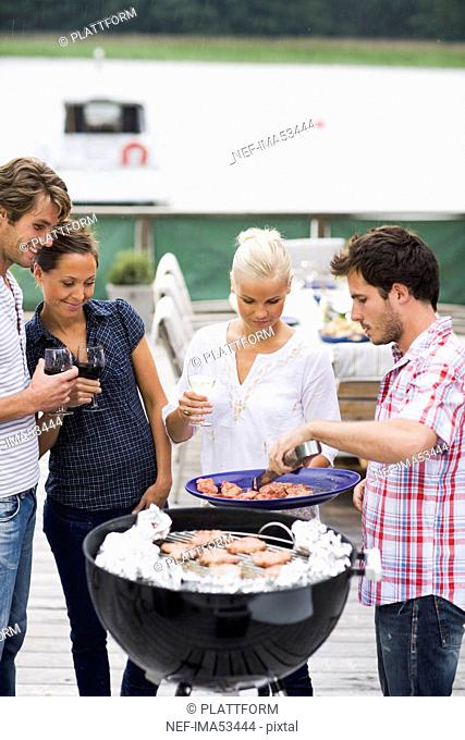 Friends having a barbeque, Sweden