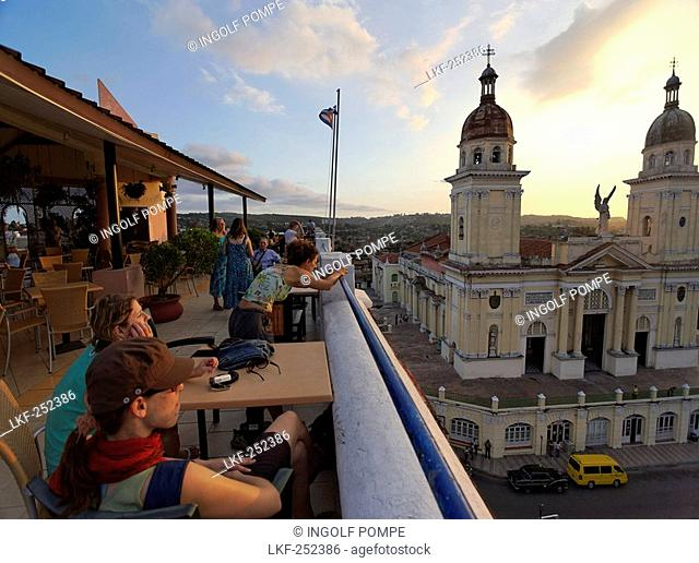 Terrace of Hotel Casa Granda, Catedral de Nuestra Senora de la Asuncion in background, Santiago de Cuba, Santiago de Cuba, Cuba, West Indies