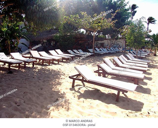 some empty deckchairs at ceara beach sands