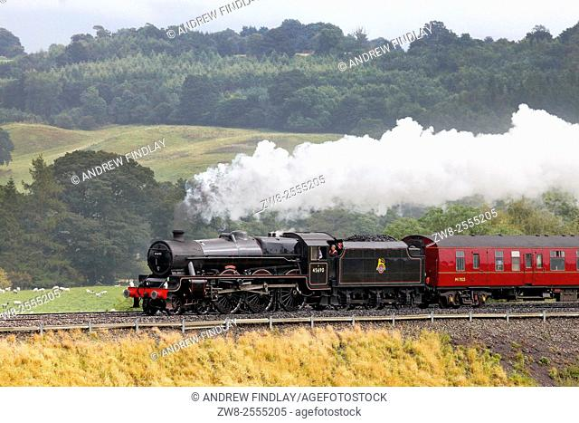 Steam locomotive LMS Jubilee Class Leander 45690 on the Settle to Carlisle Railway Line near Lazonby, Eden Valley, Cumbria, England, UK