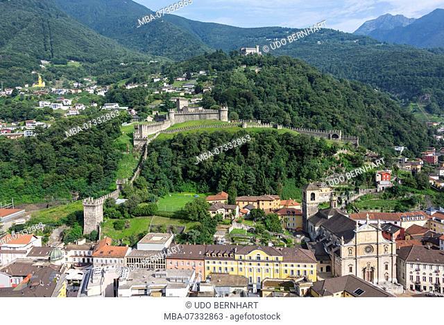 View of the city with collegiate church SS. Pietro e Stefano and castle walls Castelgrande, Bellinzona, Ticino, Switzerland