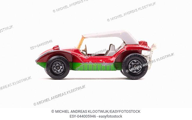 Small beach buggy car toy, isolated on white