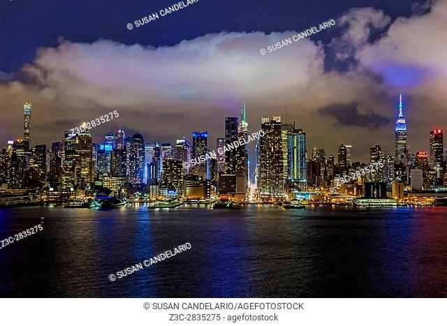 New York City Icons - The illuminated midtown Manhattan skyline with the Empire State Building (ESB) lit up in pastel colors in honor of the Easter Holiday