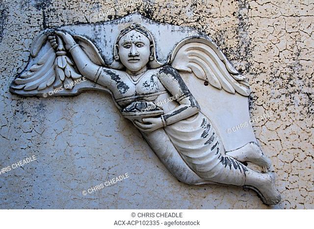 Bas-relief of Nirvana angel at at City Palace, Udaipur, Rajastan, India