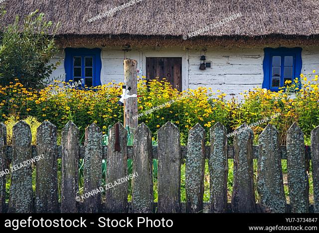 Wooden house with thatched roof in Bialowieskie Siolo inn in Budy village, Podlaskie Voivodeship in Poland